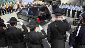 Feds Seek To Stem Police Deaths