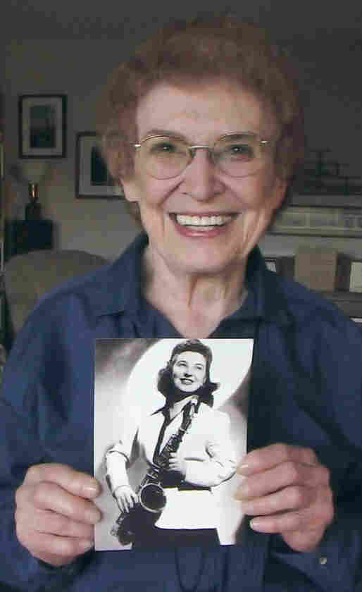 Rosalind Cron poses with a photo from her days with the Sweethearts.