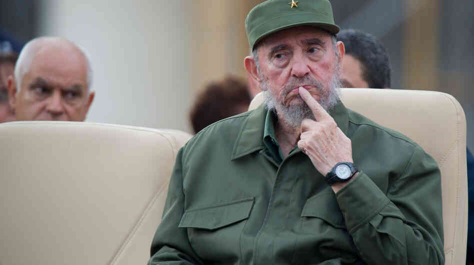 Former Cuban President Fidel Castro attends a meeting for the 50th Anniversary of the Committees of Defense of the Revolution i