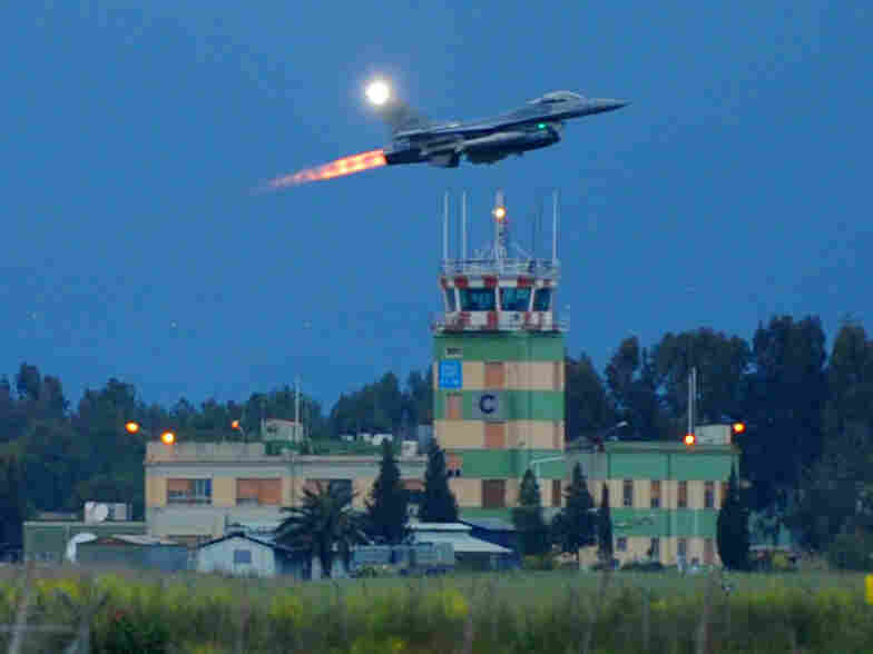 A US Navy F-16 fighter jet based at Sigonella airbase on the Italian island of Sicily takes off for operations in Libya.