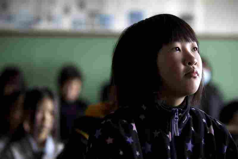 Japanese students attend an emotional graduation ceremony at the Ohya elementary school in Kesennuma.