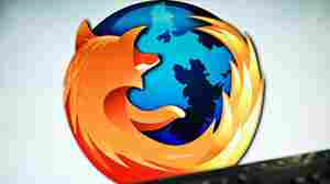 A screen displays the logo of the Web browser Firefox.