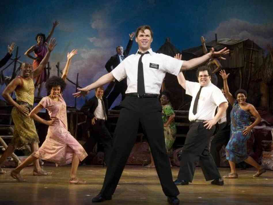 Andrew Rannells (center) and Josh Gad are two missionaries out of their depth in Northern Uganda in The Book of Mormon -- a new musical comedy from the creators of South Park and one of the men behind Avenue Q.