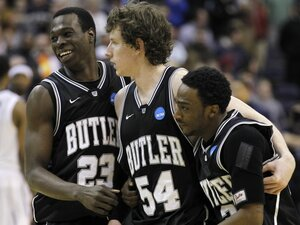 Matt Howard (center) has hit game-winning shots in each of  Butler's two NCAA tournament games. Here, he celebrates with Khyle Marshall (left) and Shawn Vanzant  after the Bulldogs upset Pittsburgh, 71-70, last weekend to reach the Sweet 16. Butler plays Wisconsin on Thursday.
