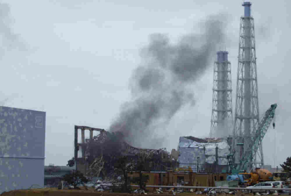 Gray smoke rises from Unit No. 3 of the stricken Fukushima Dai-ichi nuclear plant Monday. Though no country is more familiar with nuclear peril than Japan, many Japanese don't connect the nuclear bombings of World War II with the ongoing crisis at Fukushima, says Yale-trained nuclear physicist Sukeyasu Yamamoto, who teaches in Tokyo.