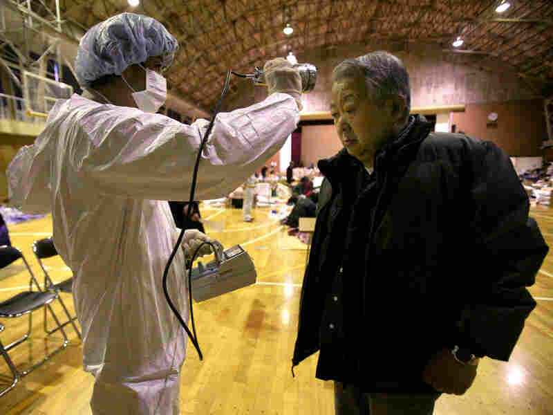 A man is screened for radiation exposure March 16 at a shelter in Fukushima city after being evacuated from an area near the nuclear facilities damaged by Japan's earthquake and tsunami.