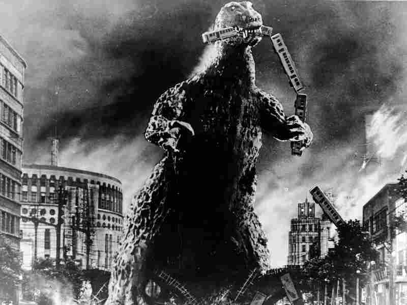 Radioactive monster Godzilla stomps through a city and eats a commuter train in a scene from the 1956 Godzilla, King of the Monsters! Fear of radiation burrowed into Japanese culture following World War II.