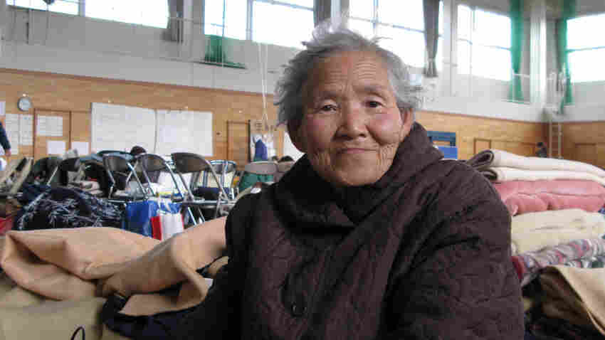 """Hisaho Koseki, 82, barely escaped the tsunami when a neighbor drove her to safety. Now she's at a local evacuation center in Kesennuma, Miyagi prefecture. Her son has offered to take her in, but she doesn't want to burden him. """"I have chronic ailments, and I don't know how much longer I'll live. I don't want to die, but in this situation, perhaps it would be better if I did,"""" she says."""