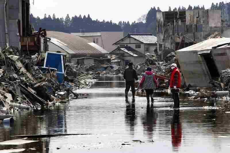 People search for the wreckage of their home in Kesennuma, Miyagi prefecture.
