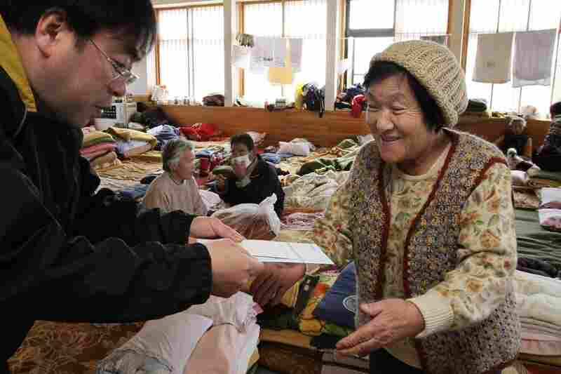 An evacuee receives mail at a shelter in Miyako.