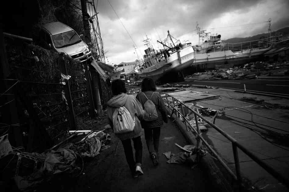 Women walk through Kesennuma, Miyagi, prefecture on Tuesday.