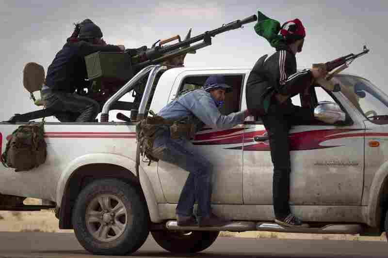 Libyan rebels retreat as mortars from Moammar Gadhafi's forces are fired on them on the outskirts of the city of Ajdabiya, south of Benghazi, eastern Libya, on Tuesday.