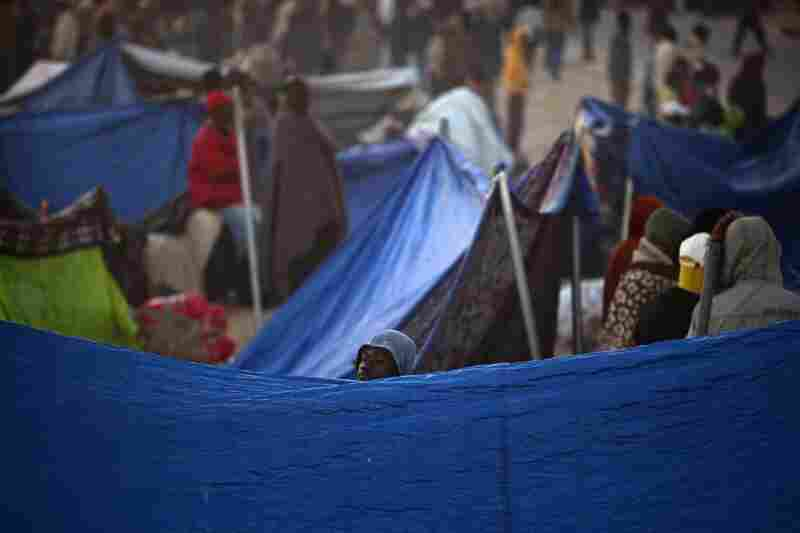 Workers who fled Libya are seen next to their makeshift shelters as they wait to be repatriated in a refugee camp in Ras Ajdir at the Tunisia-Libya border.