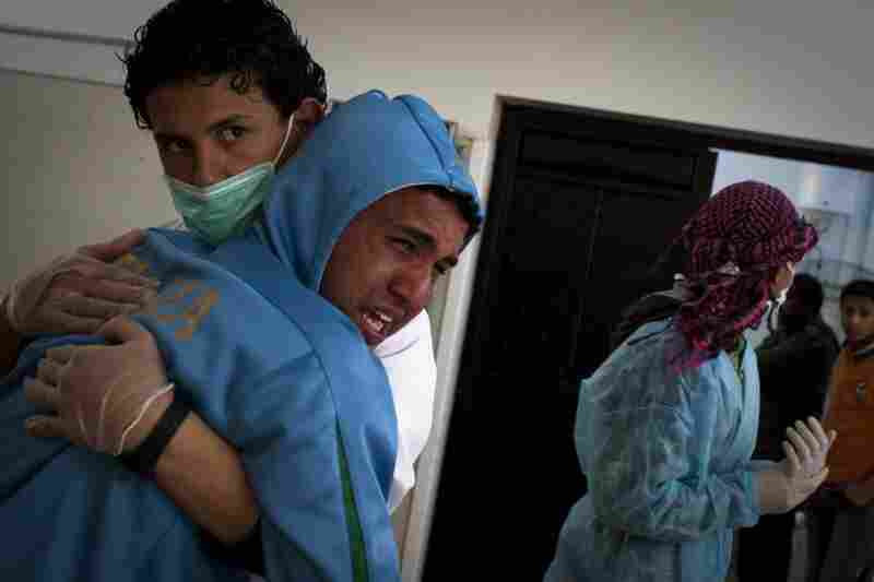 A Libyan man cries after identifying his brother at the morgue of the Jalaa hospital in Benghazi. His brother died during fighting around the city of Ajdabiya on Tuesday.