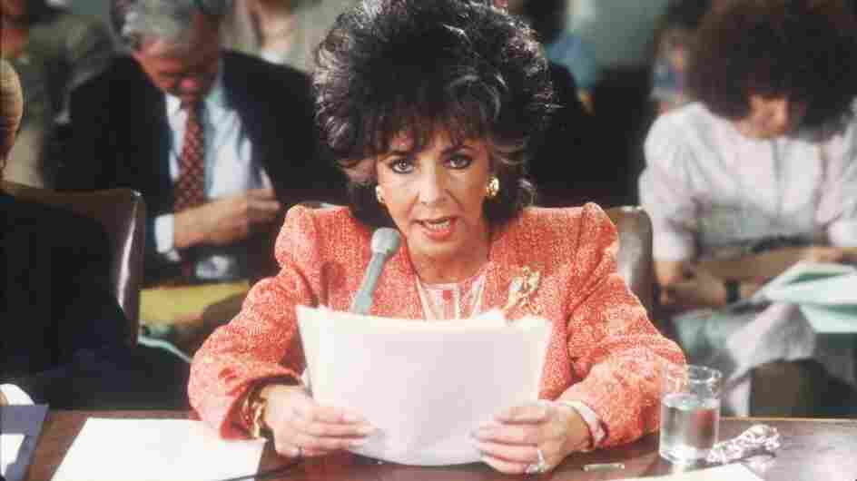 Elizabeth Taylor testifies before a U.S. Senate committee in 1986, after the death of close friend Rock Hudson in 1985.