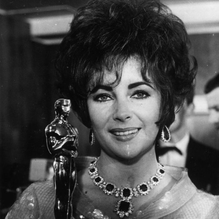 Elizabeth Taylor in 1967 with the Oscar she won for her role in Who's Afraid Of Virginia Woolf.