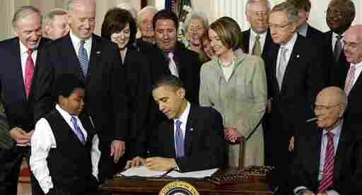President Barack Obama signs the health care bill into law,  March 23, 2010.
