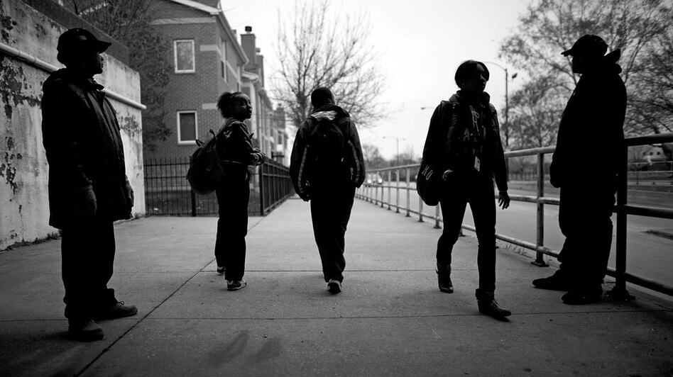 Chicago Public Schools' Safe Passage program places adults along the routes students take to and from school to keep an eye out for trouble.