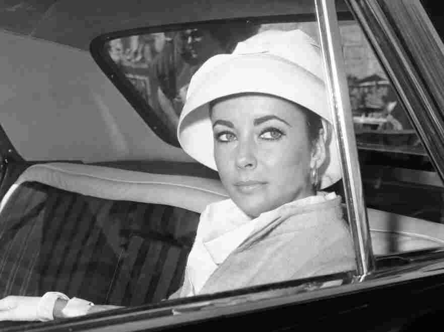 Elizabeth Taylor in a car as she left the Rome set of the 1963 film Cleopatra.