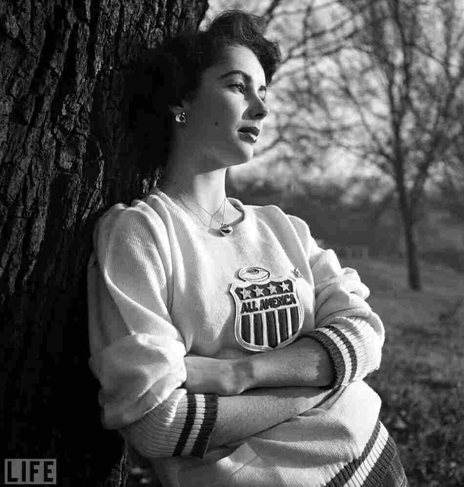 Photographer Mark Kauffman captured the young actress and her home life in 1948. The pin she is wearing belonged to Glenn Davis, a 1946 Heisman  Trophy-winning athlete she was dating at the time.
