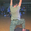 A soldier moves into the crescent pose at a daily yoga class offered at Fort Campbell in Kentucky.