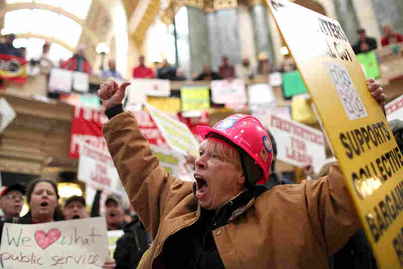 Union members return to protest inside the Capitol on March 4. They were forced to vacate the building after occupying it for more than two weeks.