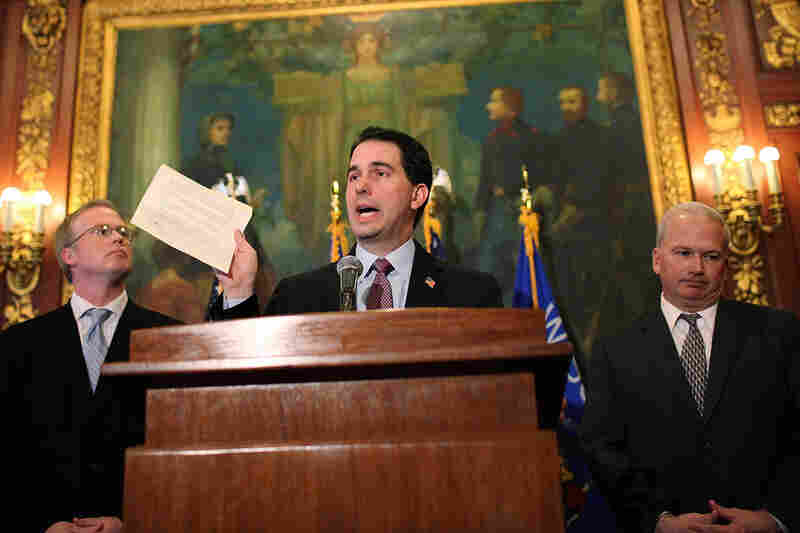 Wisconsin Gov. Scott Walker holds a letter from Democratic state Sen. Mark Miller, one of the 14 senators who fled the state more than two weeks ago, during a press conference Monday.