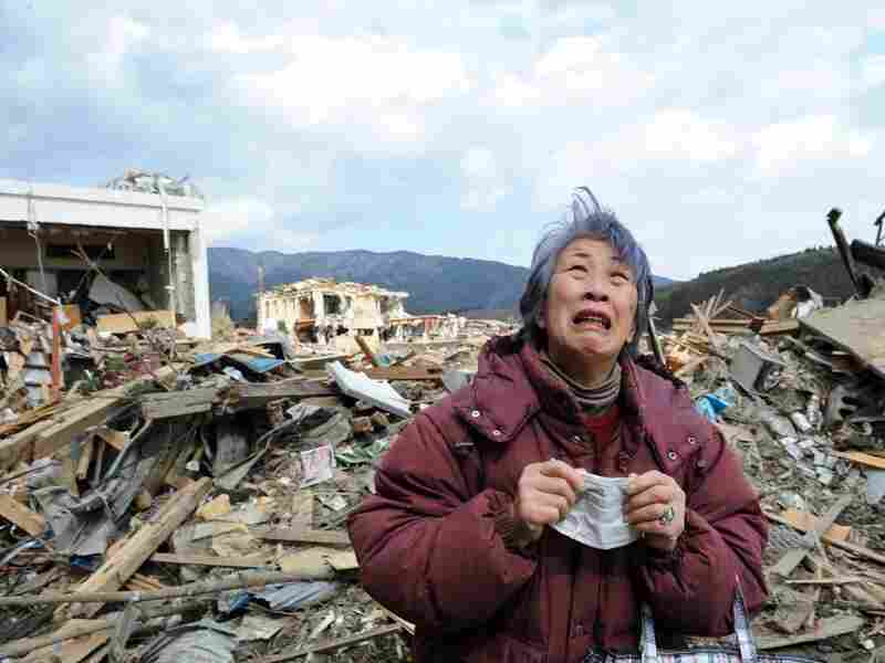 A woman cries in front of a destroyed building in the devastated Japanese town of Rikuzentakata on March 19. But it's not unusual in Japan for people to feel ashamed at showing their emotions in public, says Yoshiko Suzuki, the director of a grief counseling center in Tokyo.