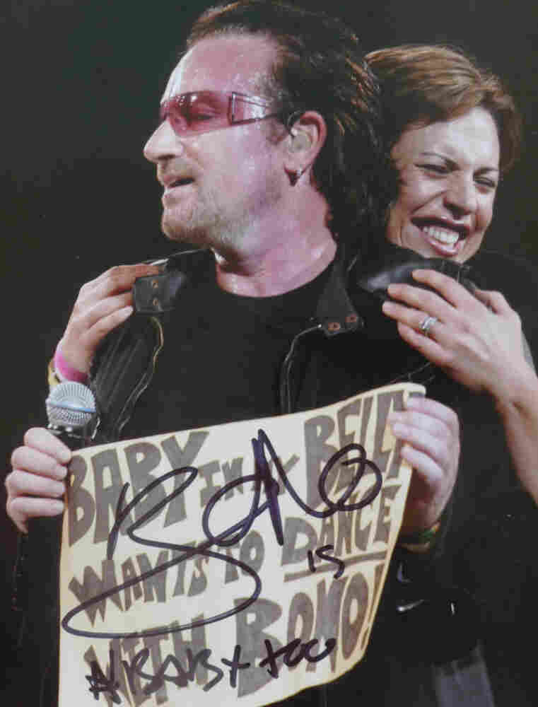 """""""Taken during the U2 Vertigo Tour in Boston, 2005. I was pulled onstage when Bono saw my sign: 'Baby in my Belly wants to Dance with Bono!' He recently signed the picture at a show during the U2 360 tour!"""""""