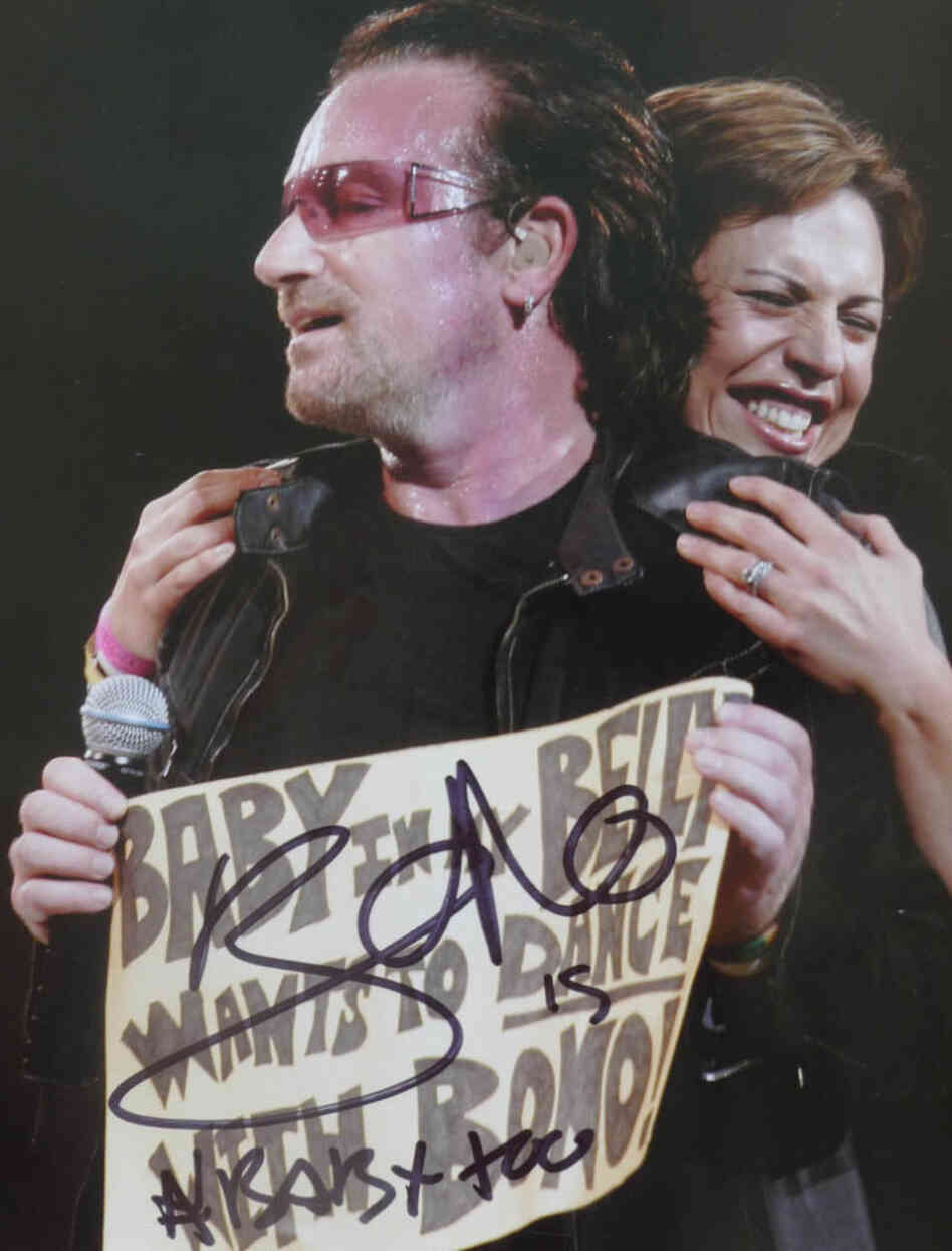 """Taken during the U2 Vertigo Tour in Boston, 2005. I was pulled onstage when Bono saw my sign: 'Baby in my Belly wants to Dance with Bono!' He recently signed the picture at a show during the U2 360 tour!"""