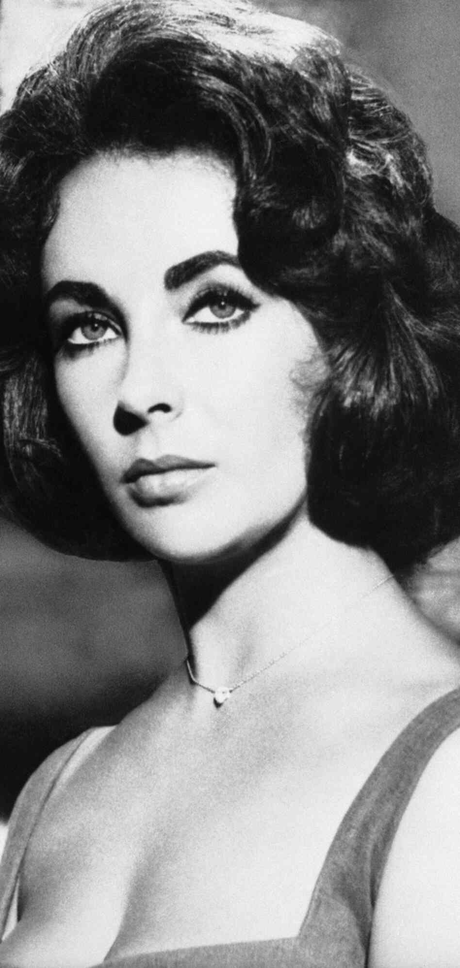 Iconic screen legend Elizabeth Taylor, pictured above in 1961, died on Wednesday. She was 79.