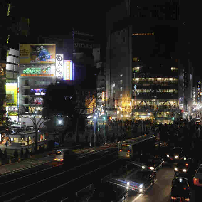 Advertising boards on buildings are seen without illumination at Tokyo's Shibuya district. Rolling blackouts are crippling a number of industries.