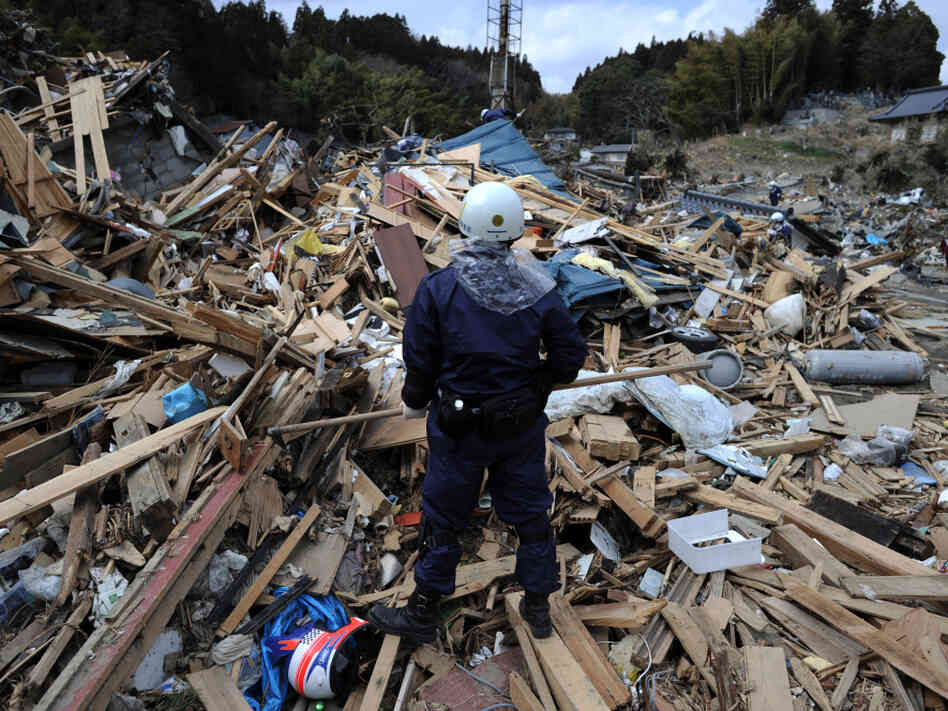 A Japanese rescue worker stands amongst the debris in Iwate prefecture on Thursday. With the dead or missing toll rising daily and an ongoing crisis at the Fukushima nuclear power plant, Japan is struggling to recover from the earthquake and tsunami that hit the country nearly two weeks ago.