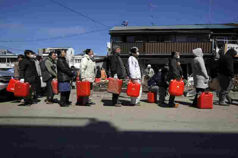 Survivors line up for gasoline in the devastated city of Ishinomaki, Iwate prefecture.