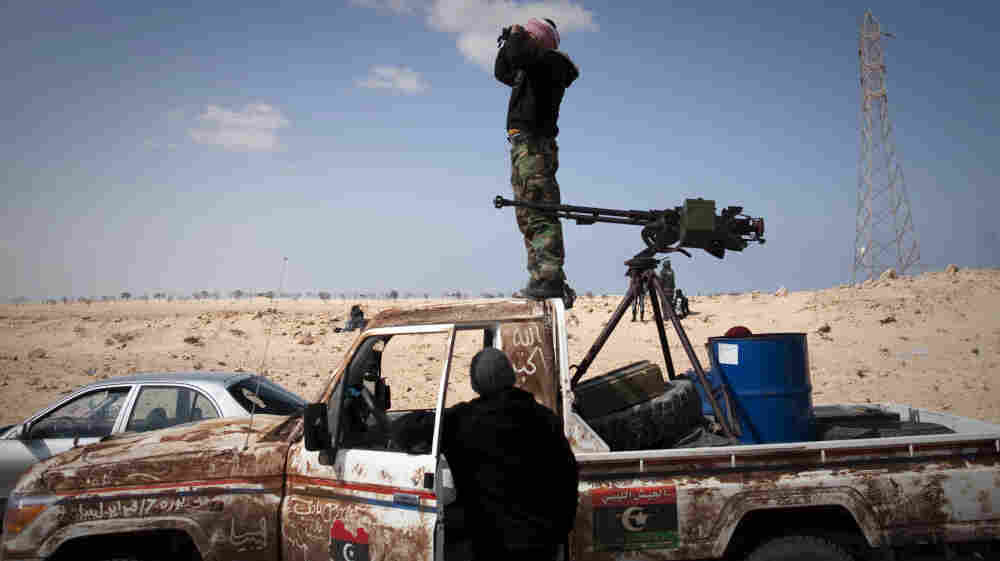 A Libyan rebel observes at a front-line checkpoint near Zwitina, the outskirts of the city of Ajdabiya, south of Benghazi, eastern Libya, on Thursday.