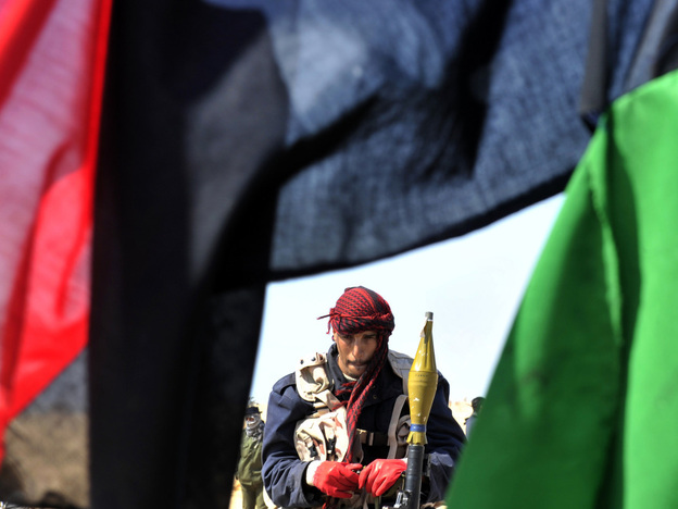 A rebel prepares to battle Moammar Gadhafi's forces a few miles from the key city of Ajdabiya, Libya, on Thursday.