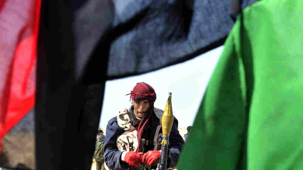 A rebel prepares to battle Moammar Gadhafi's forces a few miles from the key city of Ajdabiya, Libya, on Thursday.