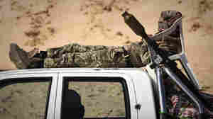 A Libyan rebel rests at a checkpoint on a front line near Zwitina, the outskirts of the city of Ajdabiya, south of Benghazi, in eastern Libya on March 24.