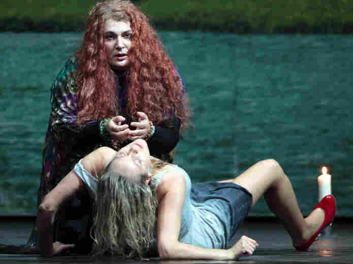 The witch Jezibaba (Janina Baechle) turns Rusalka (Christine Opolais) into a human with a powerful potion.