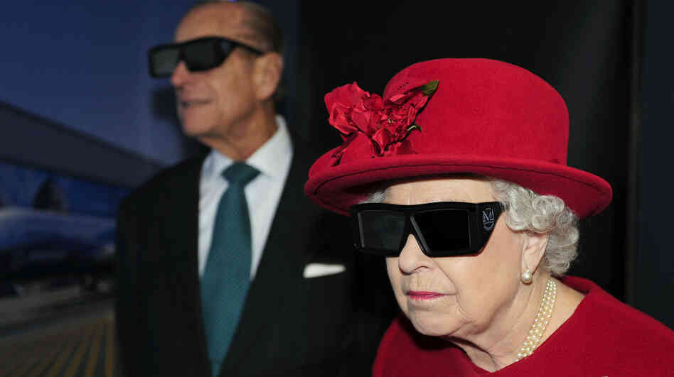 3-D glasses also present certain fashion challenges, as demonstrated here by Queen Elizabeth II and  Prince Phillip during a visit to a university research center in England.