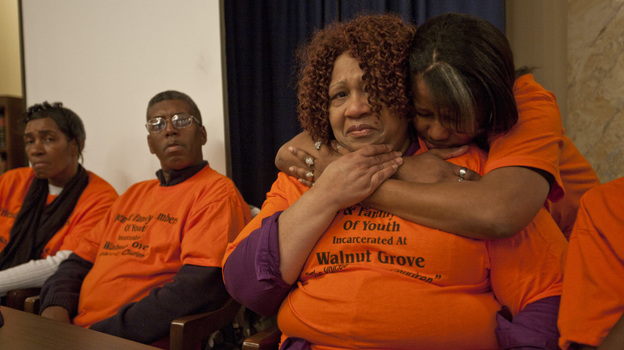 Families of youth incarcerated at the Walnut Grove Youth Correctional Facility in Mississippi listen to testimony at a hearing about alleged inmate abuse. (Phoebe Ferguson for NPR)