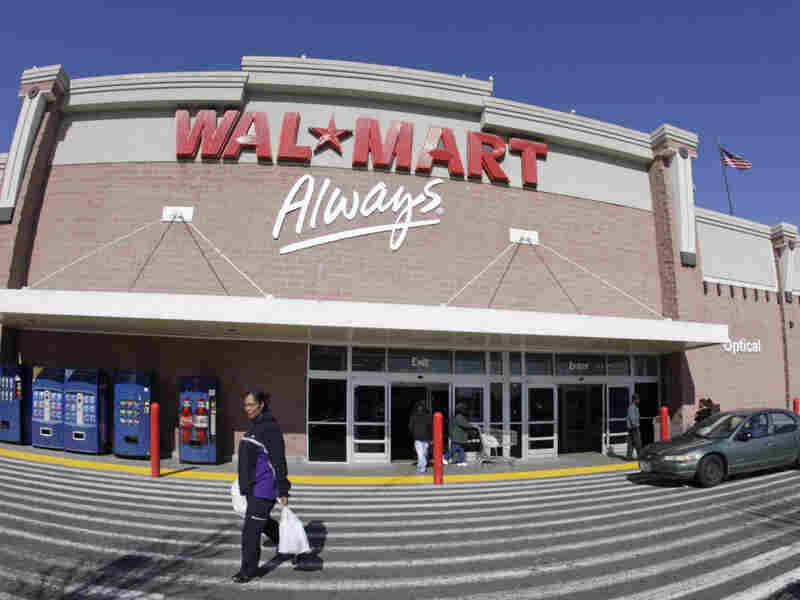 A woman makes her way out of a Wal-Mart store in Oakland, Calif. Wal-Mart is arguing that it is too big to be sued by 1.5 million of its current and former female workers.