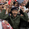 "A Yemeni army officer, center, shouts slogans along with anti-government protesters during a demonstration demanding the resignation of President Ali Abdullah Saleh on Friday. Yemen's longtime ruler told tens of thousands of supporters that he's ready to leave power but he doesn't trust his opponents, whom he called ""drug dealers."""