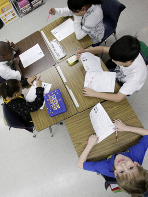 Third-graders do schoolwork during class at Hanby Elementary School in Mesquite, Texas, in February. Hispanics account for two-thirds of Texas' growth over the past decade and now make up 37 percent of the state's total population, according to census figures.