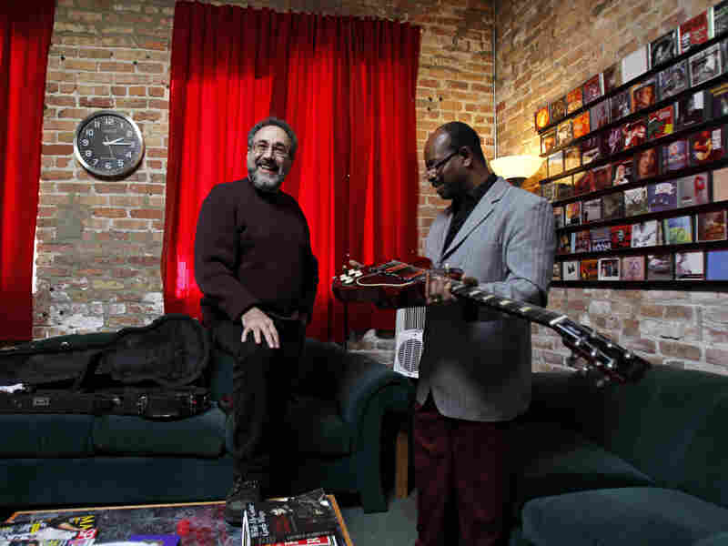 Produce Bruce Iglauer (left), founder of Alligator Records, works with blues artist Lil' Ed William at Joyride Studios in Chicago.