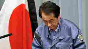 Japanese Prime Minister Naoto Kan bows as he holds a news conference in Tokyo on March 25, 2011.