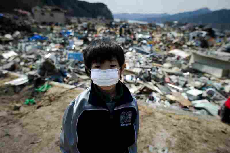 A boy stands amid destroyed houses in Yamada, Iwate prefecture.
