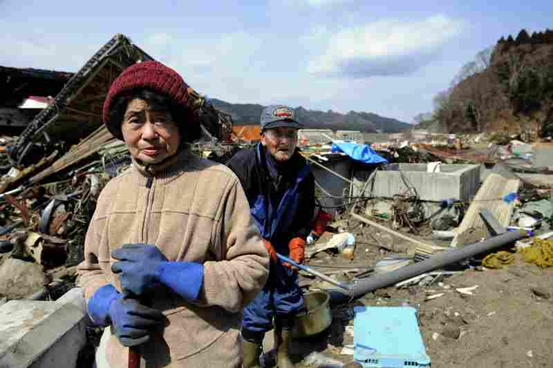 Ikuko Sasaki and her husband, Genjiro, search for their belongings near their destroyed home in Yamada, Iwate prefecture.