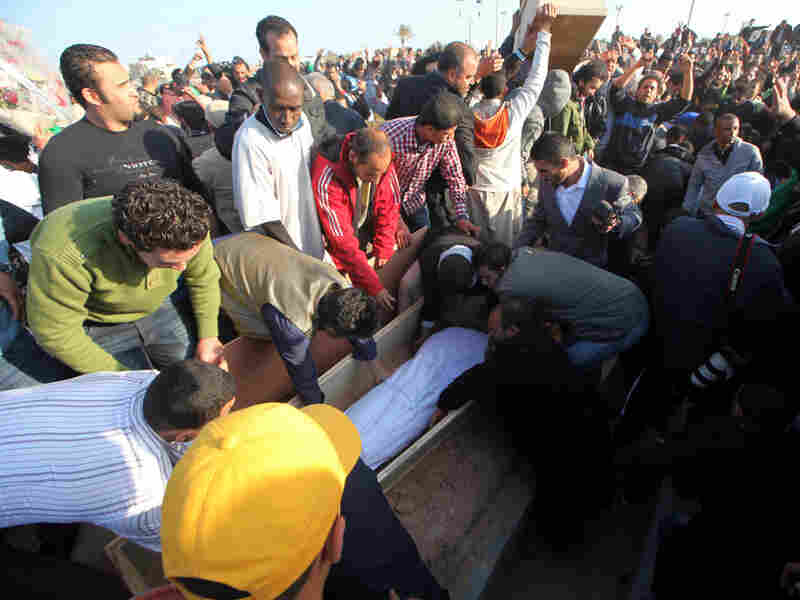 Libyans attend a mass funeral at the Shati al-Hinshir cemetery in Tripoli for people government officials say were killed in coalition attacks.