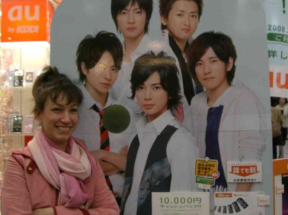 Marie Mutsuki Mockett is the author of Picking Bones from Ash. She is pictured here with a poster of the Japanese boy band, Arashi, in Kyoto, Japan. Band member Jun Matsumoto (center) played Doumyoji in the televised version of Hana
